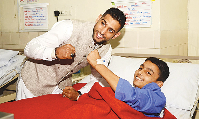 Boxing champion Amir Khan visits Army Public School Peshawar and meets the injured students, Dec 30, 2014