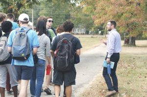 Rev. Lyn Pace and Oxford College students walk to the organic farm.