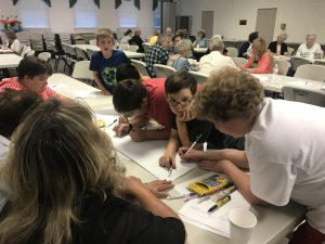 Adults and Children Work Together During Bible Study