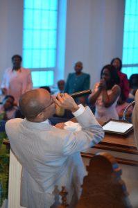 Pastor Lomax preaching Sunday Morning