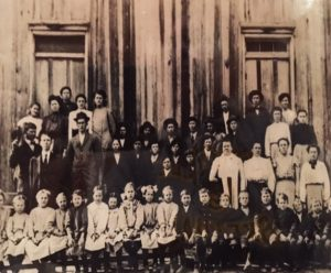 School children in front of the original church that burned in 1903.