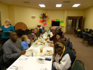 Homeless people eating dinner at Kingsway Christian Church