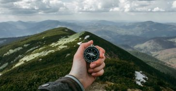 Compass navigation on top of mountain