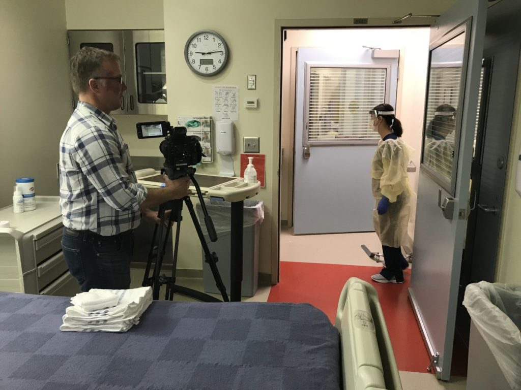 Photo of Steve Bransford shooting video for PPE training