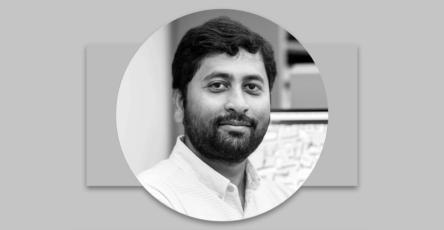 Circular headshot photo of Arya Basu against grey background