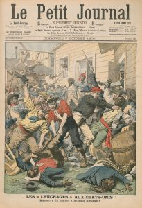 Color image of Le Petit Journal page featuring illustration depicting the 1906 Atlanta Race Riots. Newspaper text is in French and is dated October 7 1906, issue number 829. Text under the illustration reads: Les aux États-Unis: Massacre de nègres à Atlanta (Georgie). Illustration features white men beating and strangling Black men with hands and various tools of violence, including brass knuckles, sticks, and knives. Two Black men lie beaten on the ground in the foreground of the image.
