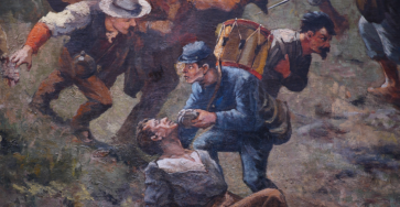Closeup of Cyclorama painting. A federal army soldier shares his canteen with a wounded foe in the thick of combat in The Battle of Atlanta, 1886.