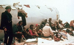 """Survivors: Passengers shelter near the tail of the Uruguayan plane which hit a mountain shrouded in mist as it flew from Santiago to Montevideo."""