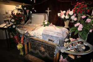 Well adorned casket set up for viewing