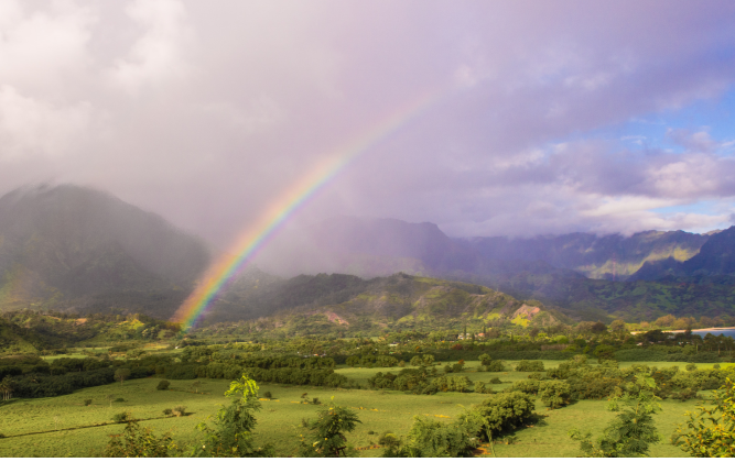 Image of a rainbow over Hawaiian mountains.