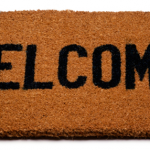 "Photo of a ""Welcome"" mat"