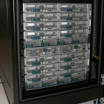 Photo of new Cisco switches in data center.