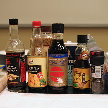 Photo of bottles of soy sauce, sesame oil, and tempura dipping sauce