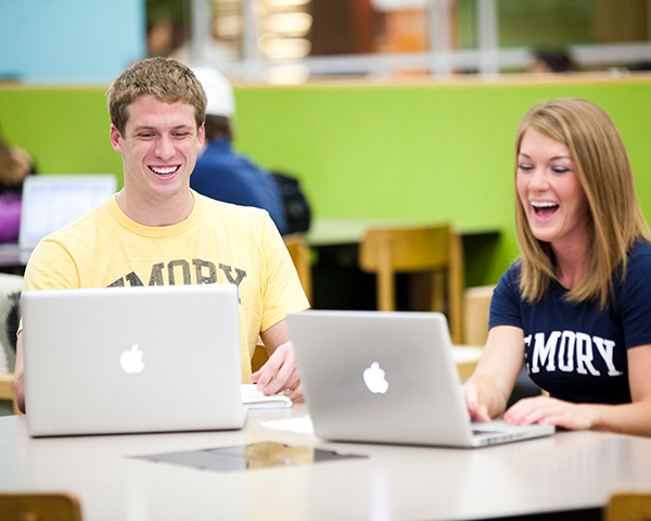Photo of two Emory students with laptops in the Woodruff Library