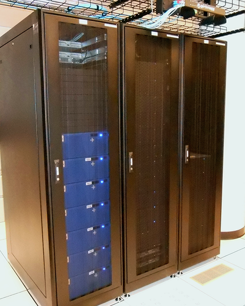 Photo of three cabinets containing VNX & Isolon storage