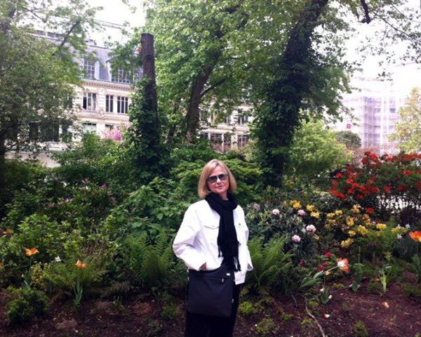 Photo of Anne Marie in a park.