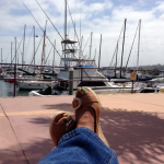 Photo of the photographer's feet while resting on a dock