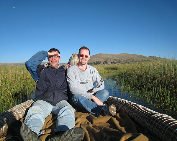 Photo of two men in a canoe