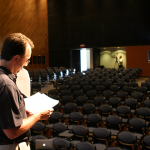 Photo of a man in an empty auditorium