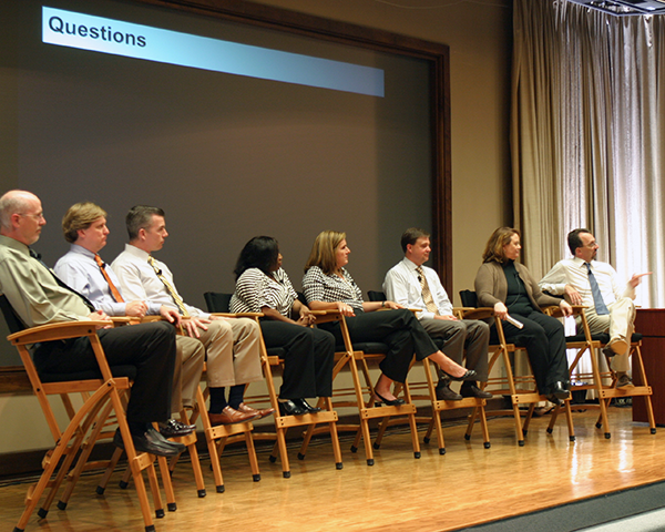Photo of IT directors onstage at an annual meeting