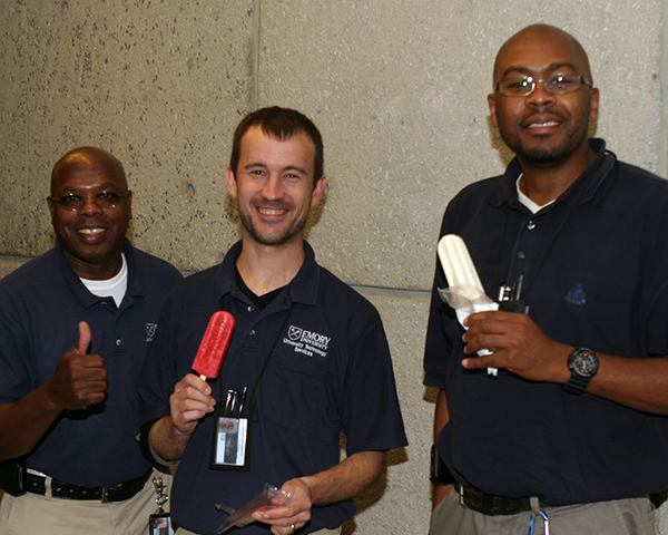 Photo of IT staff having popsicles at the conclusion of a meeting
