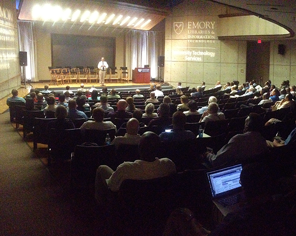 Photo of an auditorium during a presentation