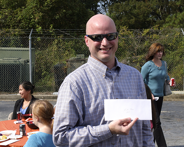 Photo of person receiving award for the best chili