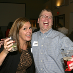 Photo of two staff members enjoying a party