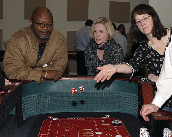 Photo of people at a gambling table
