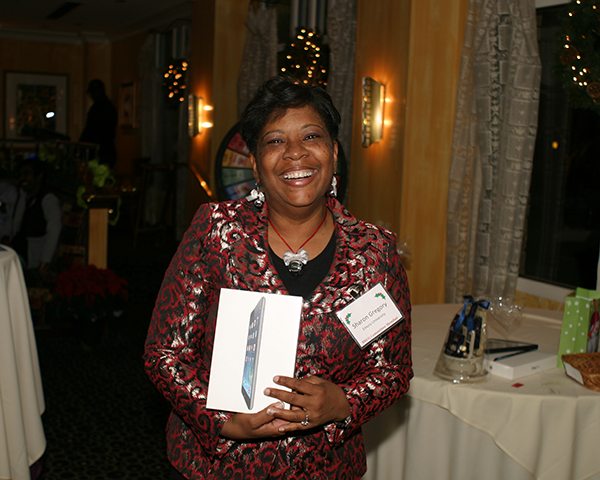 Photo of Sharon Gregory with a prize iPad