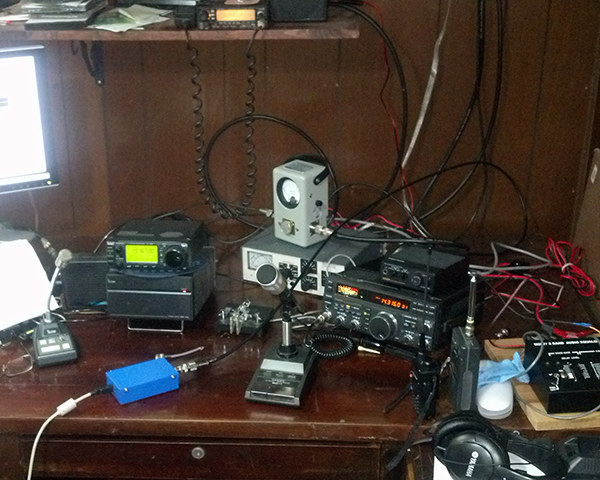 Photo of a ham radio operator's desktop with their equipment