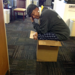 Photo of a woman squating in a box