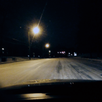 Photo of an icy road late at night