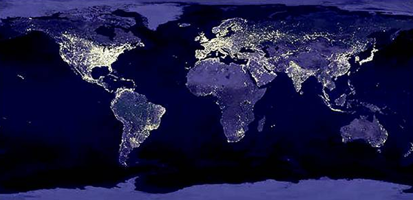 Composite image of earth with lights on in major population areas