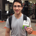 Photo of a student holding an iTunes gift card