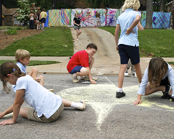 Photo of children creating a chalk mural