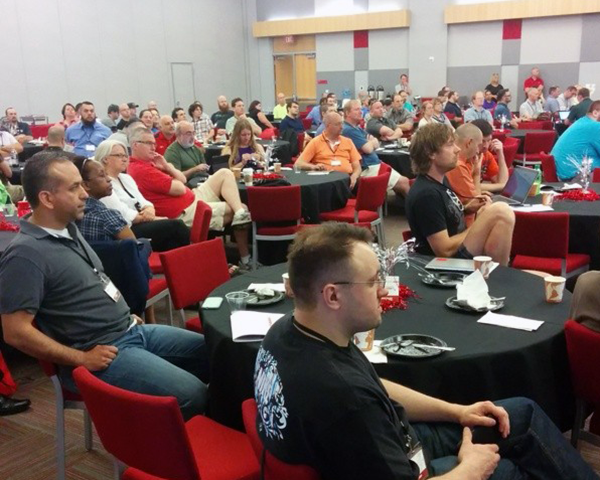Photo of conference attendees during a keynote address