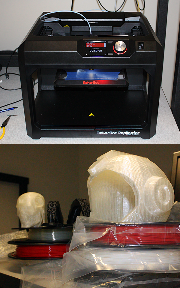 Photo of a 3D printer and a couple of printed objects