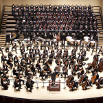 Photo of an orchestral and choral group