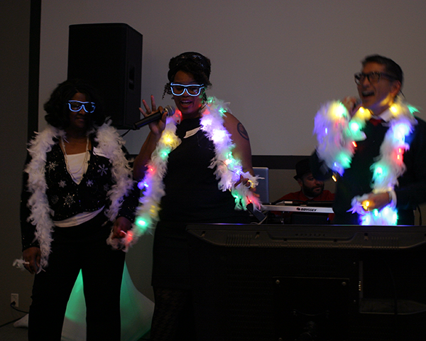Photo of people doing karaoke at a holiday party