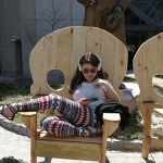 Photo of a student relaxing in a chair