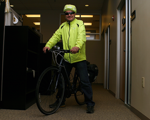 Photo of an employee on a bicycle