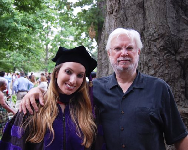 Photo of a father and daughter at a graduation