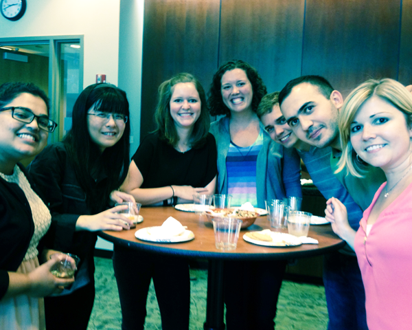 MBA students enjoying some cheese and wine.