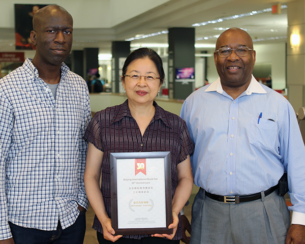 Photo of employees holding an award