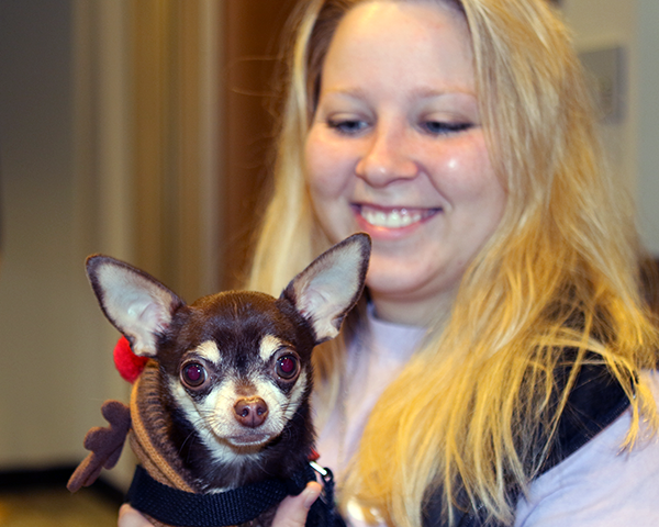 Photo of a student holding a dog