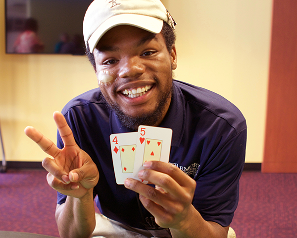 Photo of employee playing cards at a staff party