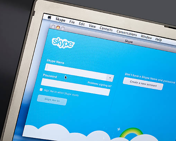 Photo of a laptop with a Skype login screen
