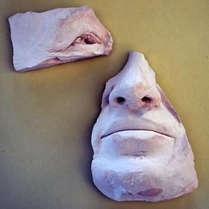 Unfinished sculpture of Derek Mahon's face