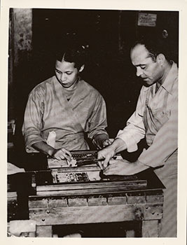 Almena Lomax and Lucius W. Lomax, Jr. setting type, c. 1950